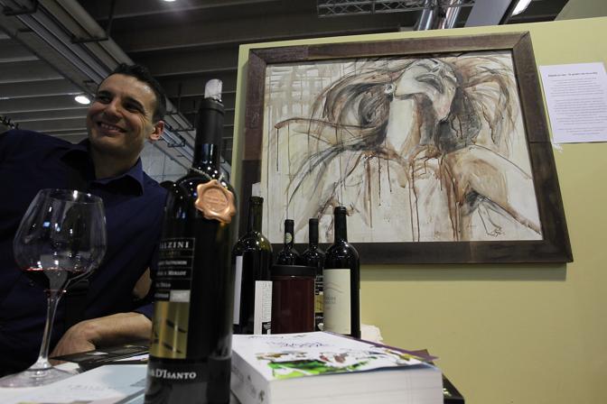 Verona, primo giorno di Vinitaly, il quadro che invecchia come il vino con cui è dipinto